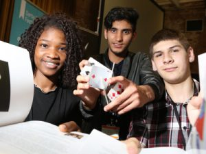 Derby College Lexis Students pose at book launch